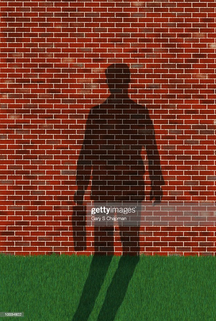 BUSINESS MAN SHADOW UP AGAINST WALL IN CONCEPT : Stock Illustration