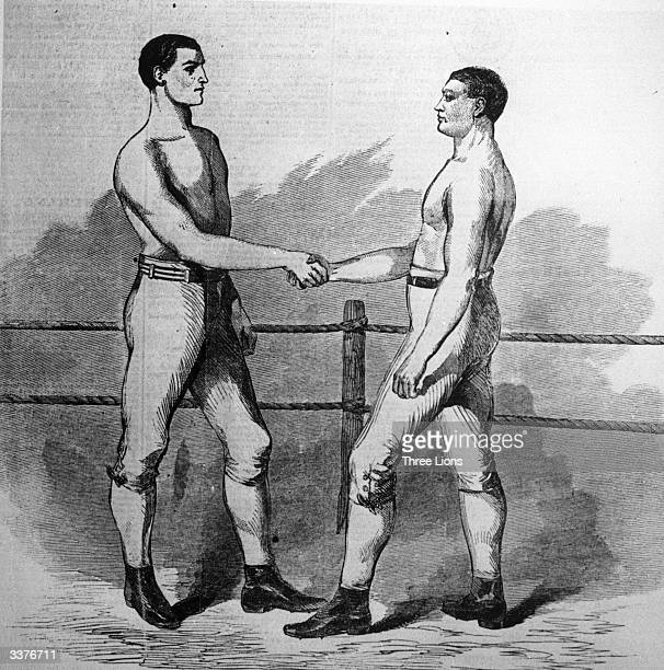 American boxer John C Heenan left shakes hands with English boxer Tom Sayers before the first international boxing championship held at an outdoor...