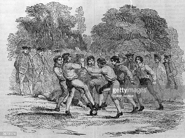 Arms and feet are used to ward off an opponent in an 18th century game of football circa 1750 Original Artwork Drawing by William Howitt Holidays For...