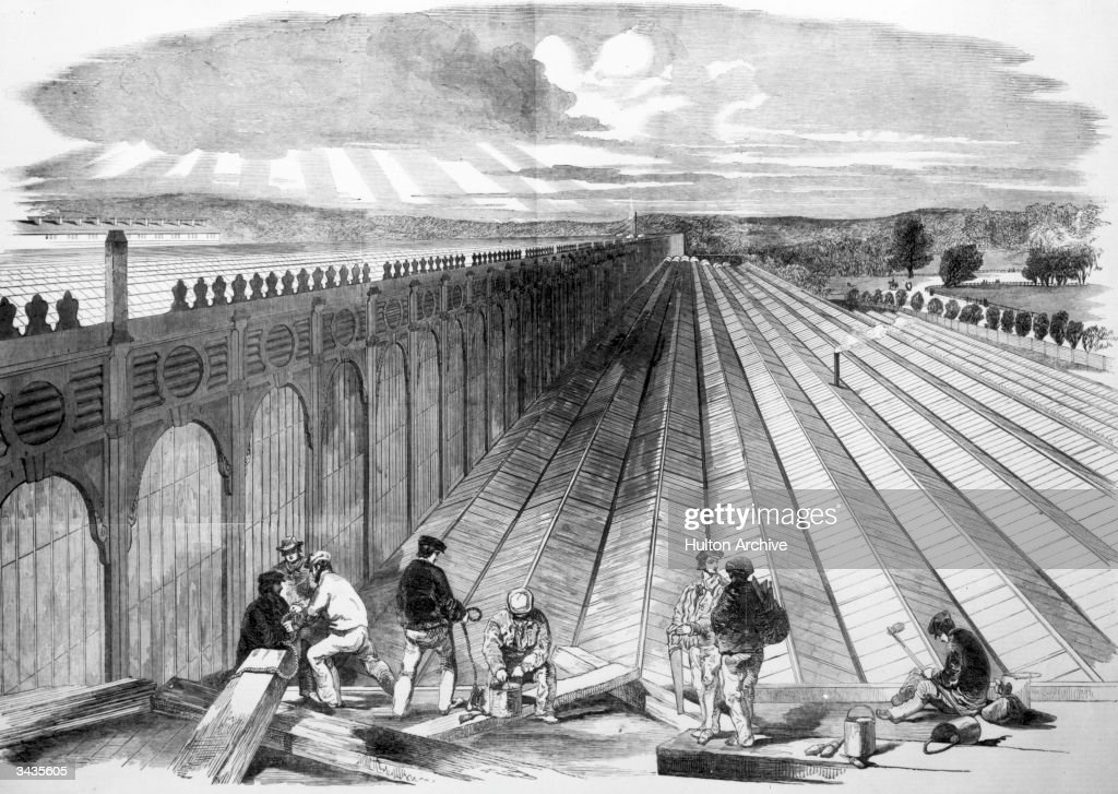 Workmen constructing a portion of the ridge and furrow glass roof of the Crystal Palace in London's Hyde Park. The massive iron and glass structure was designed by Sir Joseph Paxton as the venue for the Great Exhibition of 1851. Original Publication: Illustrated London News - pub. 1851