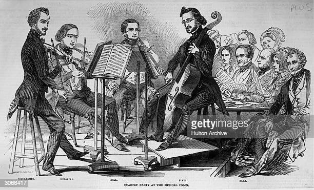 From l to r violinist Henri Vieuxtemps with other members of a quartet Deloffre Hill and cellist Alfredo Piatti playing in a chamber music concert in...