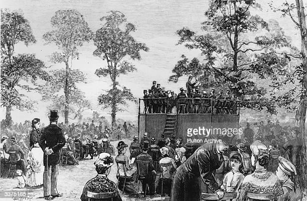 A band playing to an audience from a bandstand in Hyde Park London Original Publication The Graphic pub 1881