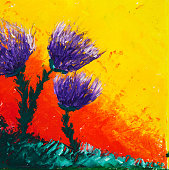 Original oil painting on canvas showing colorful abstract flowers in front of golden sunset