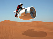 Futuristic motorcycle and pilot is flying with new generation jet technology on the desert.