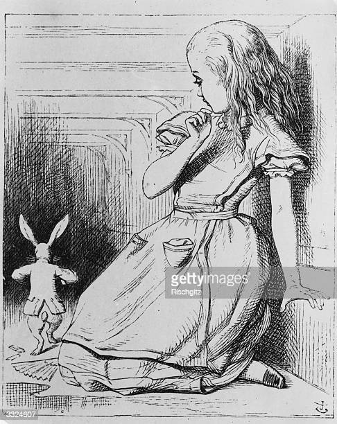Alice watches the white rabbit as he walks away from her From 'Alice in Wonderland' by Lewis Carroll Alice In Wonderland 1st Edition pub 1865...