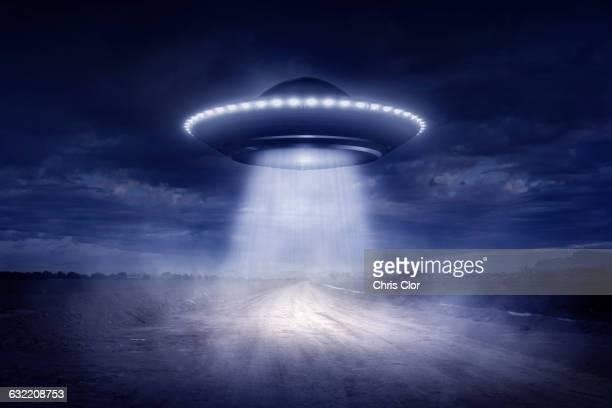 Alien spaceship landing on rural road