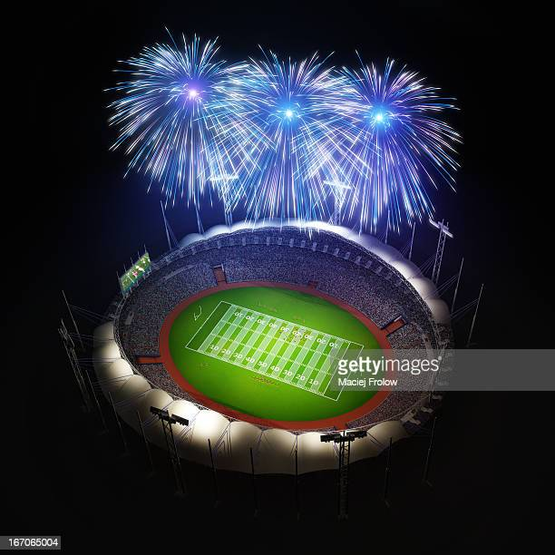 American football stadium with fireworks above