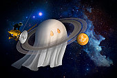 An artist's Halloween illustration of Cassini and Saturn, as the new Equinox mission at Saturn begins.