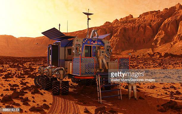 An explorer departs a manned rover ina martian canyon.