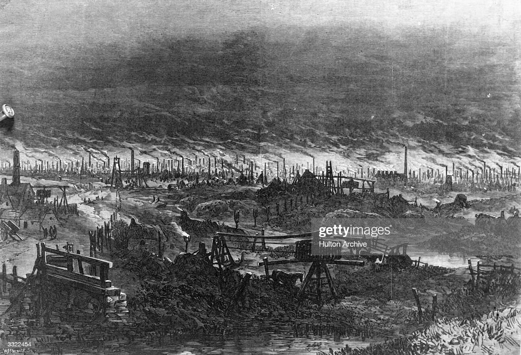 An industrial landscape around Wolverhampton showing hundreds of smoking industrial chimneys with marshy land in the foreground Original Publication...
