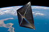 Artist concept of NanoSail-D in space.