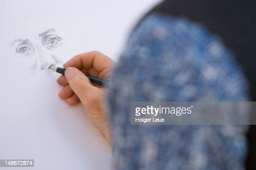 Artist drawing portrait in Piazza IV Aprile. : Stockillustraties