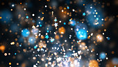 Background with glittering particles which can be used for any fashion, party or celebration related designs and presentations.