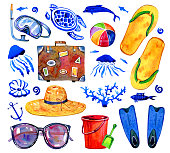 Beach objects and sealife hand drawn watercolor set.  Flippers, suitcase, ball, glasses, bucket, turtle, fishes, corals and jellyfishes isolated on white background
