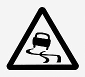 Black and white illustration of slippery road symbol in black triangle