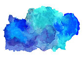 Watercolor blue paint stain closeup isolated on a white background