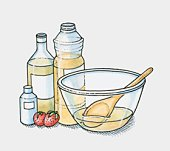 Bottles of olive oil, vegetable oil and coconut oil and two strawberries by a mixing bowl (making moisturiser)