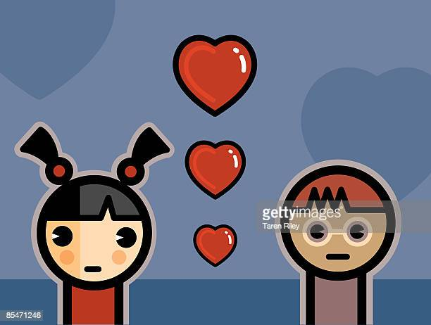 A boy and a girl and three hearts floating between them