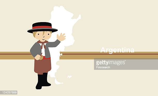 Boy in traditional clothing in front of the map of Argentina