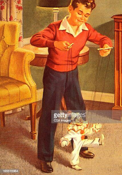 Boy Playing with a Marionette