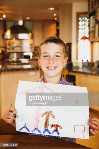 Boy showing colored drawing : Stockillustraties