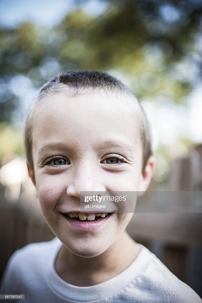 boy (8ys) smiling, outdoors : Stock Illustration