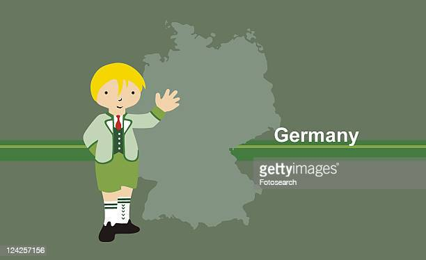 Boy wearing traditional German clothing in front of the map of Germany