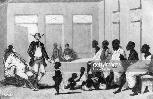 Brazilian slave traders inspect a group of Africans shipped into the country for sale