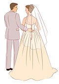 Bridal couple standing side by side, groom putting arm around bride, rear view