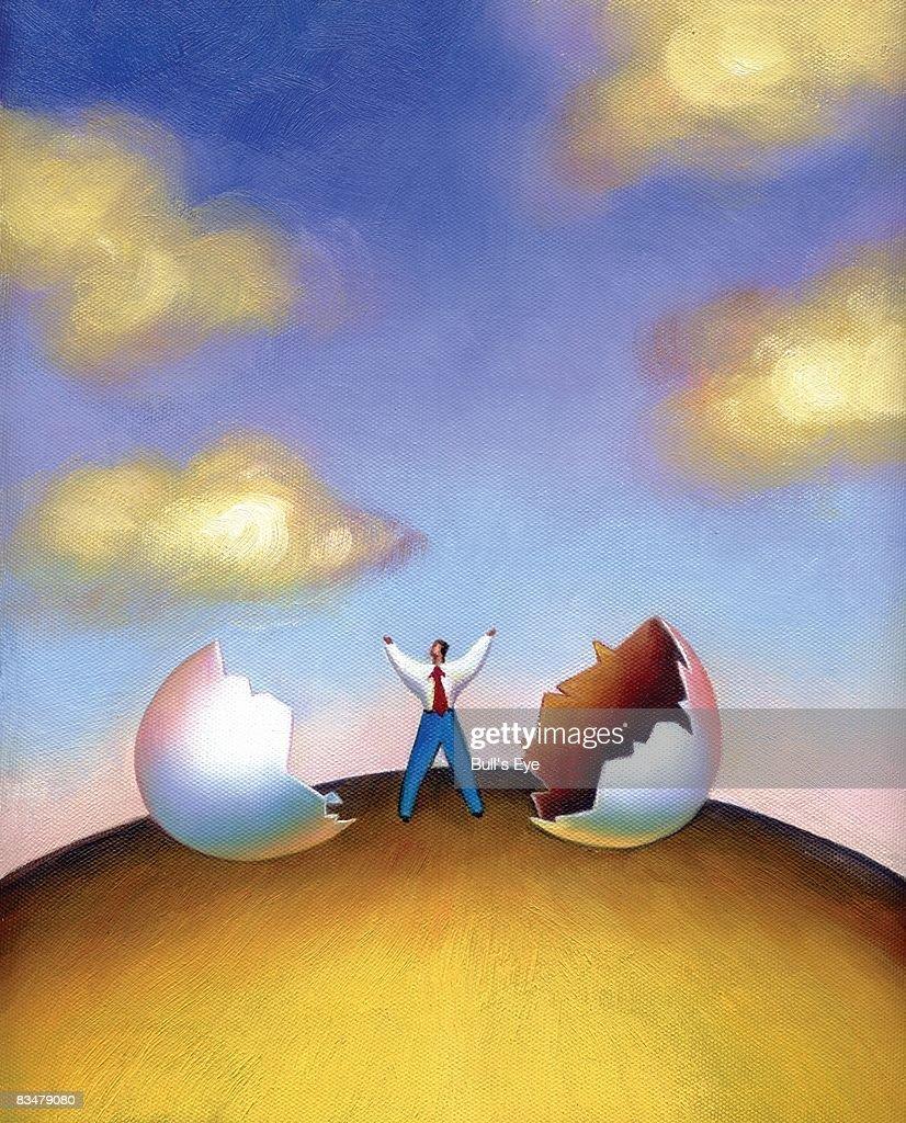 Businessman just emerged out of a broken egg : Stock Illustration