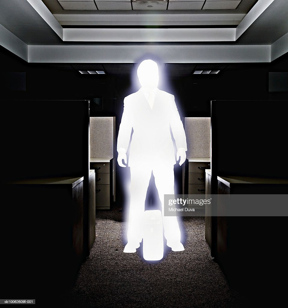 Businessman standing in office with briefcase : Stock Illustration