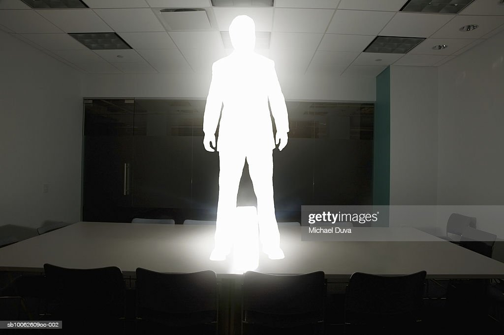 Businessman standing on conference table with briefcase : Stock Illustration