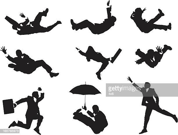 Businessmen falling through the sky