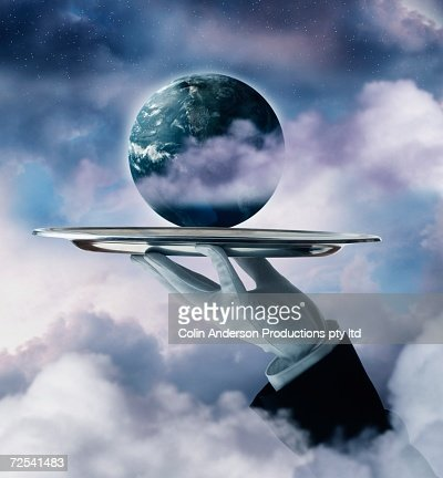 Butler's hand holding planet Earth on silver platter : Stock Illustration