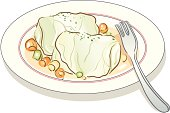 Cabbage rolls on plate with spoon