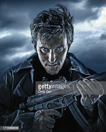 Caucasian man holding machine gun outdoors : Stock Illustration
