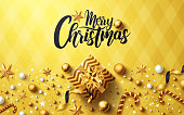 Christmas and New Years Golden background with golden gift box,ribbon and christmas decoration elements for Retail,Shopping or Christmas Promotion in golden style.Vector illustration