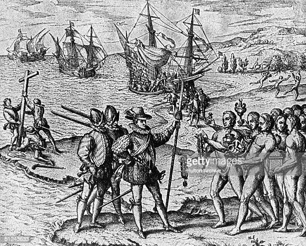 1492 Christopher Columbus lands on Watling Island and meets the natives while three of his shipmates erect a cross