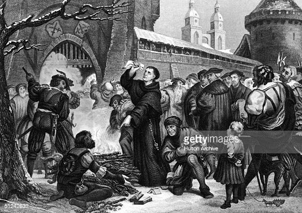 Circa 1518 Martin Luther standing before a fire with the work of Johann Tetzel in his hand Tetzel and Luther wrote theological works arguing with the...