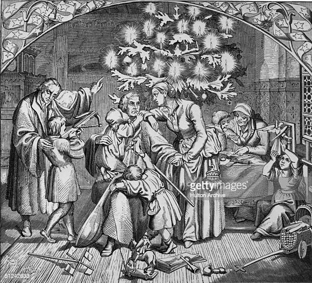 Circa 1535 A busy family Christmas in the household of German theologian Martin Luther
