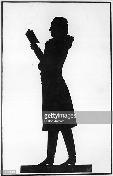 A silhouette portrait of the German writer and poet Johann Wolfgang von Goethe reading a book Original Publication From 'Goethe's Aussere...