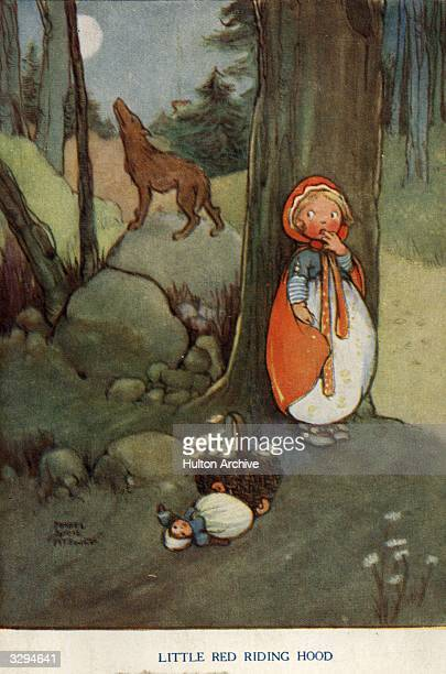 Little Red Riding Hood hides from the wolf in the forest in this postcard taken from the fairy tale by the brothers Grimm Raphael Tuck Sons Grimm's...