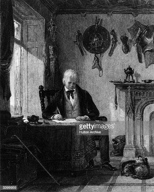 Scottish author Sir Walter Scott at work in his study at his home Abbotsford House in Galashiels south eastern Scotland
