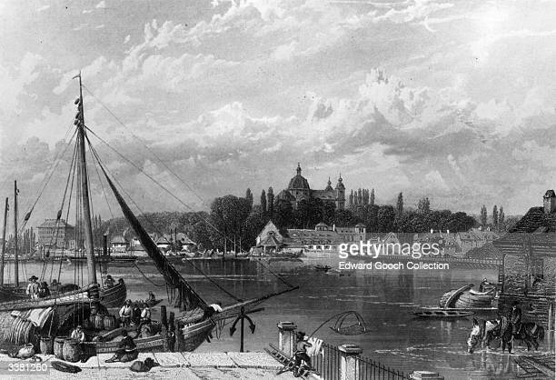 The port of the city of Mannheim in southwest Germany at the junction of the Rhine and Neckar rivers An engraving by E I Robert after a drawing by B...