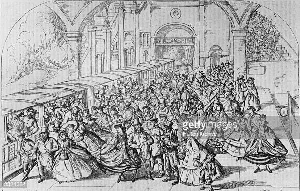 Crowds trying to get into the carriages at Crystal Palace railway station at the end of a fete day Original Artwork Drawn by W McConnell Engraved by...