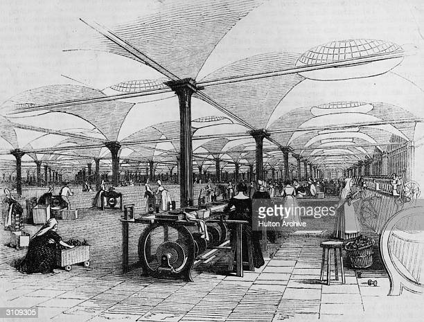 The interior of Marshall's flax mill in Leeds with women workers at the spinning machines Penny Magazine Vol 12 Illustration of Interior of...
