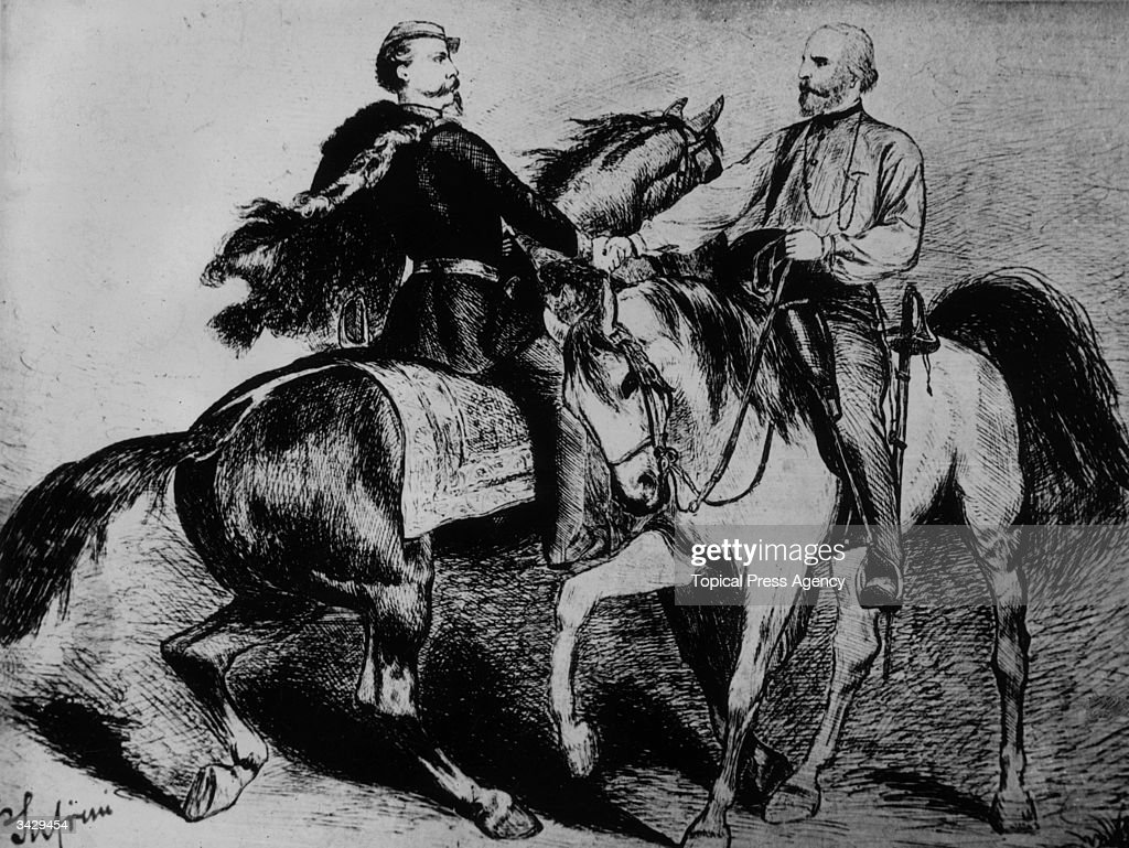 Italian patriot Giuseppe Garibaldi (1807 - 1882), leader of the 'Red Shirts' shakes hands with King Victor Emmanuel II (1820 - 1878) known as the 'honest king' and the first king of a unified Italy.