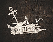 Anchor, lighthouse, ship and crane icons on brush stroke. Calligraphy inscription. Dubai city name text