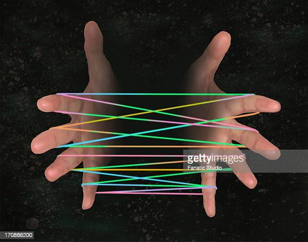 Conceptual image of human hand with cat's cradle representing business networking over black background