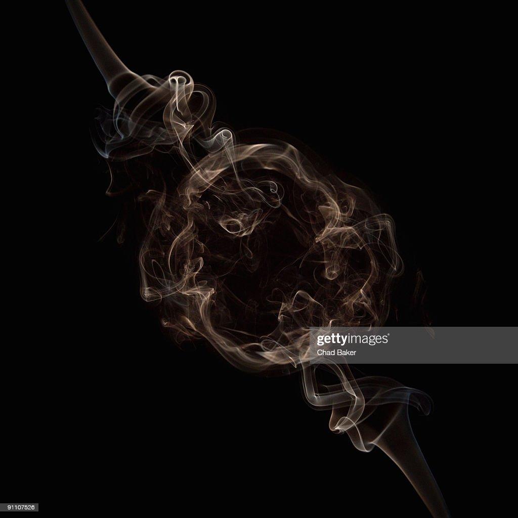 Curls of smoke creating circular frame : Illustration